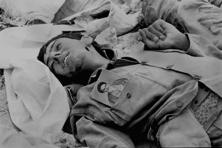 Iranian killed soldier during Iran-Iraq war with Rouhollah Khomeini's photo on his uniform. Photo: Kaveh Golestan